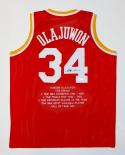 Hakeem Olajuwon Autographed Red Stat Jersey- JSA Witnessed Authenticated