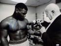 Mike Tyson Autographed B&W 16x20 Lacing Gloves Photo- JSA Witnessed Auth