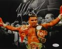 Mike Tyson Autographed *Silver 8x10 Arms In Air Photo- JSA Witnessed Auth