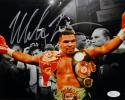 Mike Tyson Autographed *Silver 8x10 Arms In Air Photo- JSA Authenticated
