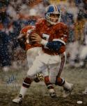 John Elway Autographed Denver Broncos 16x20 Snow Photo- JSA Witnessed Auth