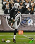 Marquette King Autographed Oakland Raiders 8x10 Punting PF. Photo- JSA W Auth