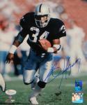 Bo Jackson Autographed *Blue Oakland Raiders 8x10 Running PF. Photo- JSA W Auth