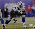 Tyron Smith Autographed Dallas Cowboys 8x10 In Stance Photo- JSA Witnessed Auth