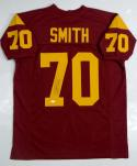 Tyron Smith Autographed Burgundy College Style Jersey- JSA Witnessed Authenticated