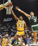 Magic Johnson Autographed 16x20 Lay Up Against Celtics Photo- JSA Authenticated