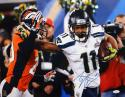 Percy Harvin Autographed 16x20 Super Bowl Stiff Arm Photo- JSA W Authenticated