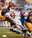Brian Cushing Autographed 8x10 Tackling Griffin Photo- JSA W Authenticated