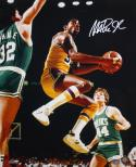 Magic Johnson Autographed 16x20 In Air Against Celtics Photo- JSA Authenticated
