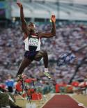 Carl Lewis Autographed 16x20 Front View In Air Photo- JSA W Authenticated
