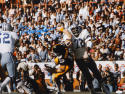 "Ed ""Too Tall"" Jones Autographed Cowboys 16x20 Hitting Bradshaw Photo- JSA Auth"
