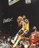 Magic Johnson Autographed 16x20 In Air w/ Houston Photo- JSA Authenticated