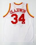 Hakeem Olajuwon Autographed White Jersey- JSA Witnessed Authenticated