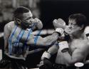 Mike Tyson Autographed 8x10 Fighting Rocky B&W Photo- JSA Witnessed Auth
