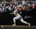 Rickey Henderson Autographed Oakland A's 16x20 Running Horz *White - JSA W Auth