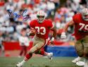Roger Craig Autographed 49ers 8x10 Horizontal Running Photo- JSA W Auth *top blue
