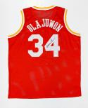 Hakeem Olajuwon Autographed Red Jersey- JSA Witnessed Authenticated