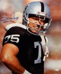 Howie Long Autographed Raiders 16x20 Standing Photo- JSA W Authenticated